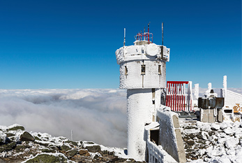 The frozen tower at the summit of Mount Washington.