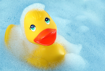 Rubber duck in a tub full of bubbles.