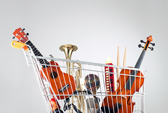 A shopping cart full of musical instruments.