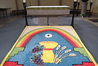 A flower carpet in a chruch during Corpus Christi feast.