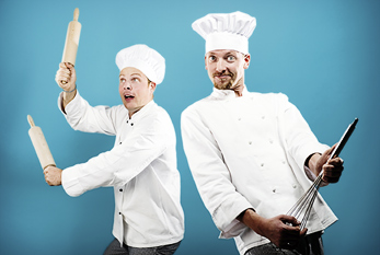Two culinarians using their kitchen equipment as instruments.