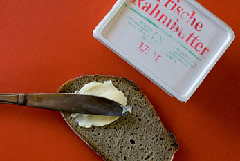 "A German ""Butterbrot"" (bread with butter) beneath a pack of German butter."