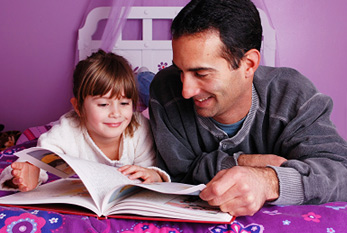 A father and daughter spend time reading a fairy tale.