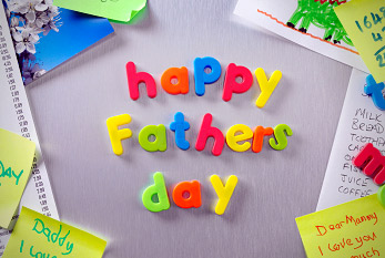 Happy father's day notice written on a metal background.
