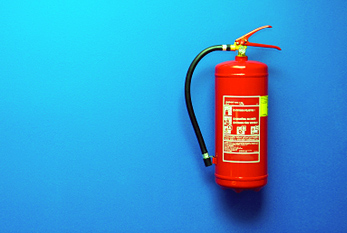 Fire extinguisher on a blue wall