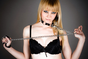Bondage fetish: woman in underwear with a leash in hand.
