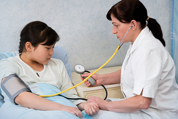 A nurse checking the blood pressure.