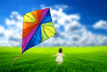 Girl flying a kite in a meadow