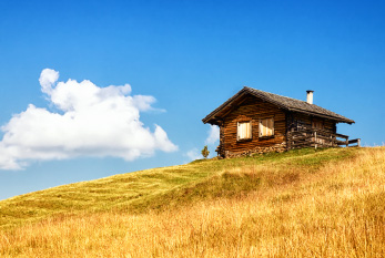 Old log cabin on a hill.