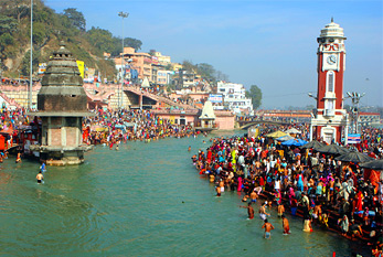 Puja ceremony on the banks of Ganga, people celebrate Makar Sankranti.
