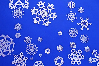 Paper cut out snowflakes.
