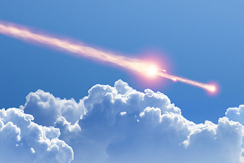 Asteroid impact against blue sky and clouds. The explosion of the Tunguska event is believed to have been caused by the air burst of a small asteroid.