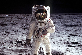 Buzz Aldrin walks on the surface of the Moon during Apollo 11.