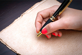 Woman about to write on a recycle black coffe paper