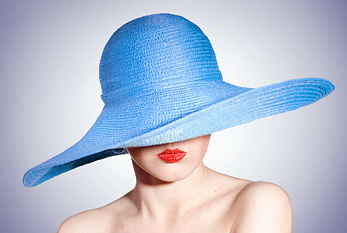 Portrait of attractive elegant woman in blue hat.