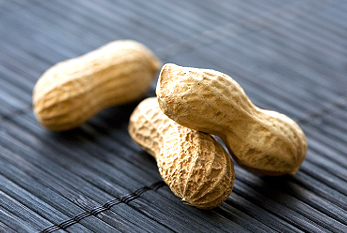 Three peanuts in ther shell.