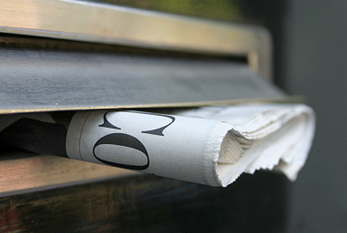 Newspaper in a mailbox