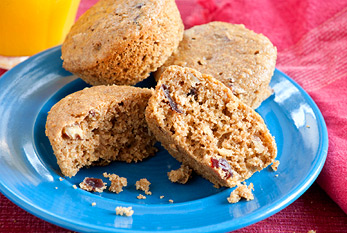 A plate of cranberry-pecan overnight oatmeal muffins.