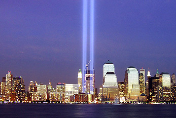 Two beams of light represent the former Twin Towers of the WTC during the memorial of the 9/11 attacks.