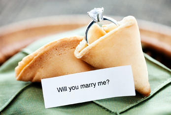 "A ring in a fortune cookie together with the question ""Will you marry me?"""