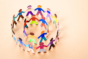 Two paper chains showing people from all over the world holding hands.