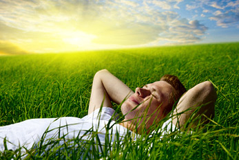 Young man relaxing in the grass.