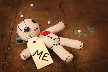 "A voodoo doll saying ""me"" on Self-injury Awareness Day."