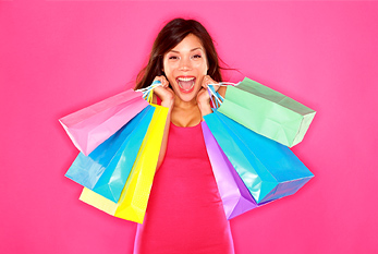 Shopping woman happy excited and cheerful holding shopping bags