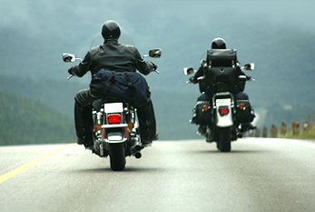 Two bikers on the highway.