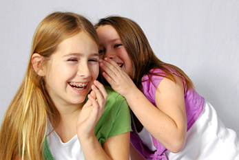 Two girls laughing at a shared joke