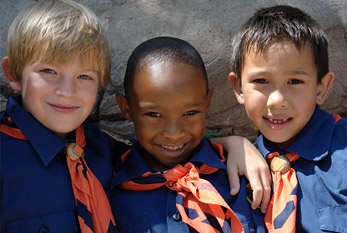 Three boy scouts in scout uniform.