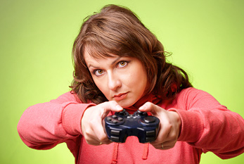 Woman with gamepad playing a videogame.