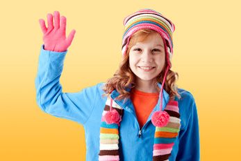 A girl waving with all five fingers.