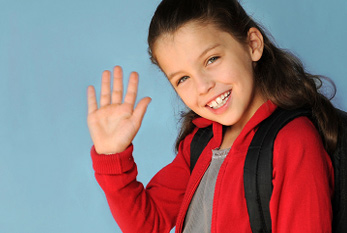 Little girl waiving: on World Hello Day you should say hello to ten people.