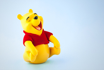 Winnie the Pooh laughing out loud.