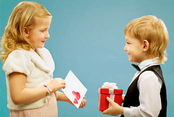 Two kindness children exchanging presents.