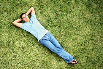 Just find the mental balance: A man lying relaxed in a meadow.