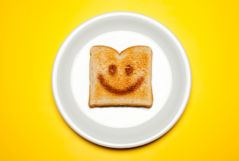 Smiling face on a toast.